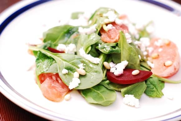 Spinach salad with beets, goat cheese, pine nuts, grapefruit