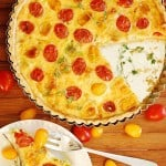 Breakfast tart with eggs, Gruyere cheese, leeks, thyme, and grape tomatoes