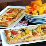 Puff pastry pizza with bell peppers, mushrooms, and Mozzarella cheese