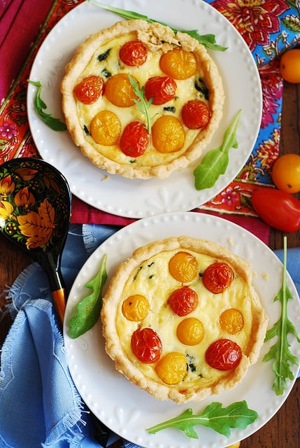 Baked egg cups with spinach, cheese, and grape tomatoes for breakfast