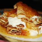 Crepes with ricotta cheese filling and pears roasted in honey