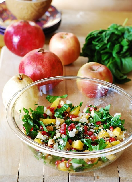 Chopped salad with fruit, pomegranates, nuts, and Gorgonzola cheese