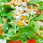 Arugula salad with walnuts, golden raisins, and Gorgonzola cheese