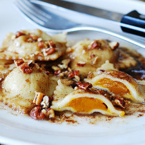 Pumpkin ravioli with brown butter sauce and pecans