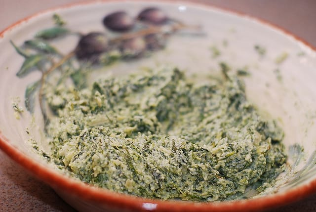 mixing spinach and ricotta cheese