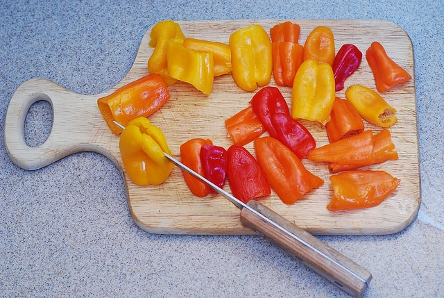 sliced bell peppers for Puff pastry pizzas with mushrooms, bell peppers, Mozzarella and Parmesan cheese
