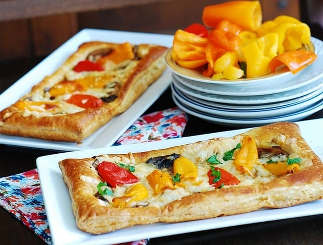 puff pastry pizza, pizzettes with mushrooms, bell peppers, cheese