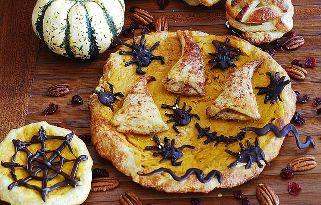 Pumpkin puff pastry pie, tart with apple-cranberry stuffed crust, chocolate bugs and cinnamon wizard hats, from scratch