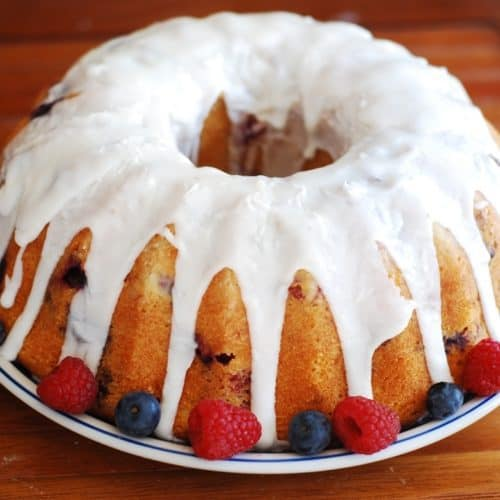 Blueberry, blackberry, raspberry bundt cake with lemon glaze