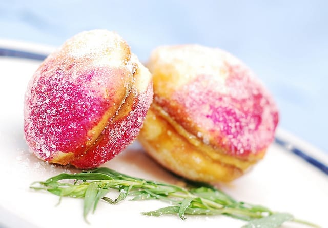 Peach shaped cookies with dulce de leche filling
