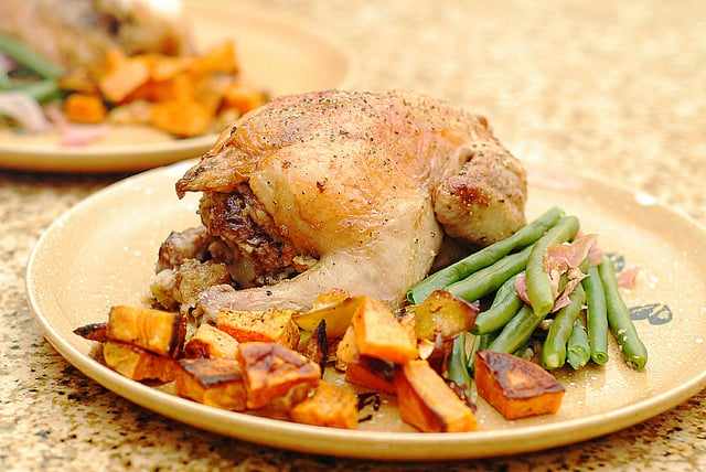 Thanksgiving cornish game hens with dried fruit, pecan, fig, proscuitto stuffing