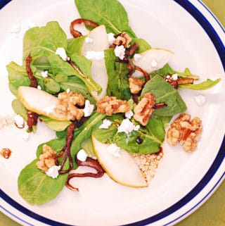 Arugula salad with caramelized onions, brown sugar walnuts, pears, and crumbled Gorgonzola cheese