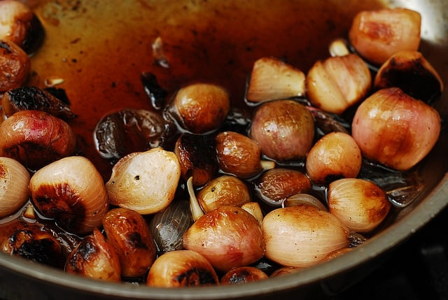 small onions cooking, shallots