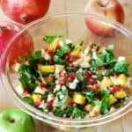 chopped salad with spinach, apples, pears, pomegranate seeds