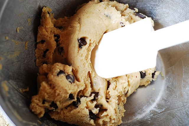 chocolate chips are mixed into the cookie dough