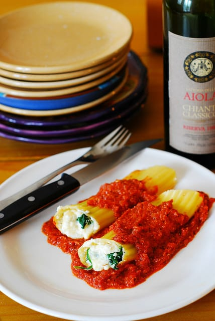 Stuffed manicotti pasta shells with ricotta cheese and spinach filling