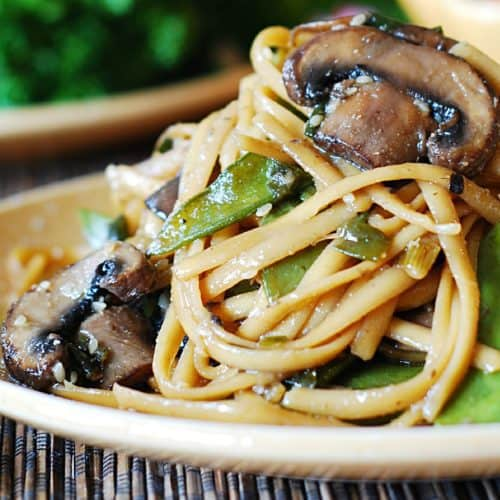 spicy asian noodles with mushrooms and peas