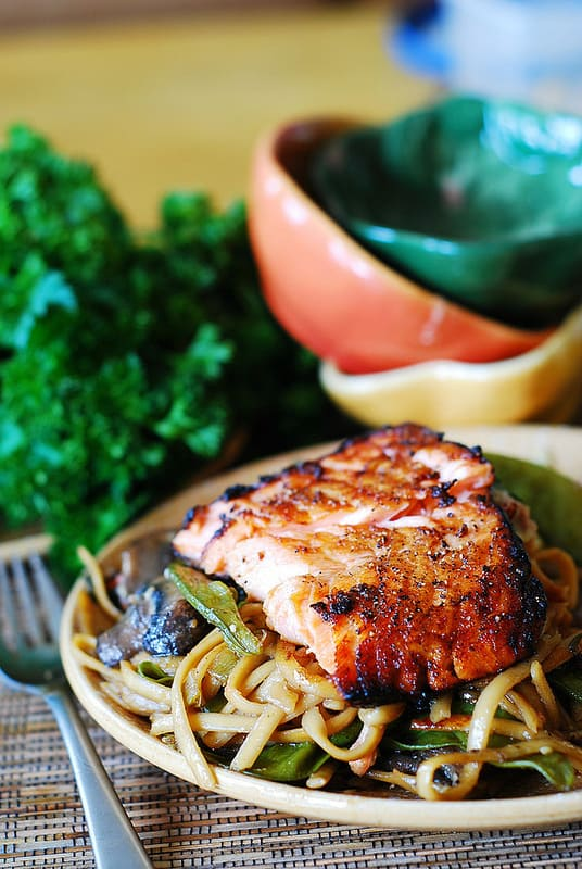 Honey-soy salmon tossed with Asian noodles with mushrooms and snow peas in Sriracha flavored, honey-sesame sauce