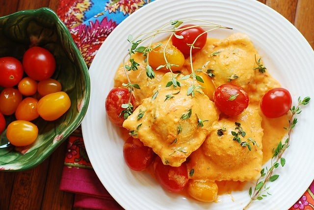 Ravioli with spinach and ricotta cheese filling, in tomato cream sauce