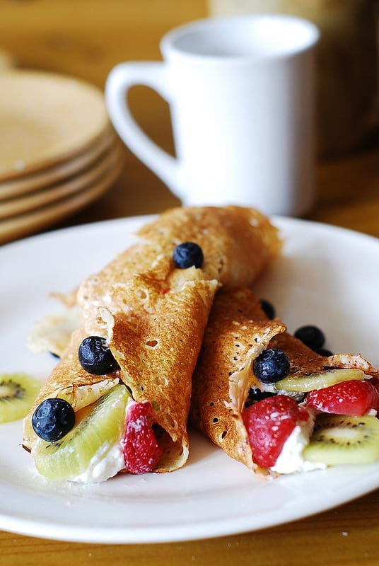 Dessert crepes with ricotta cheese, berries, and kiwi