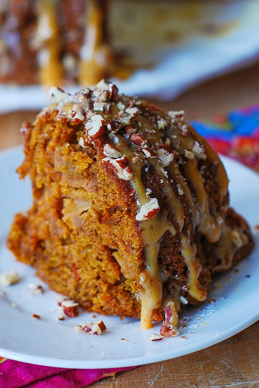 Apple Pumpkin Bundt Cake with Caramel Drizzle and Chopped Pecans