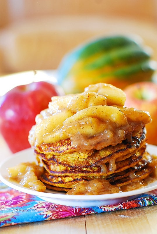 Pumpkin Pancakes with Apples cooked in butter, brown sugar, cinnamon, nutmeg, and vanilla extract