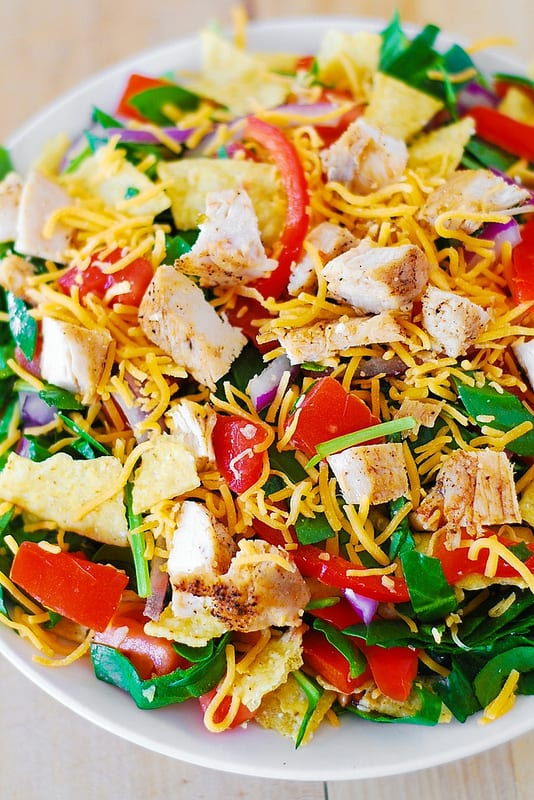 Chicken Taco Salad with Spinach, Tomatoes, Bell Pepper, Tortilla Chips, and Cheddar Cheese