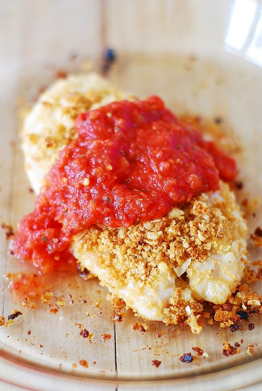 Coat the chicken with bread crumbs and Parmesan cheese then with marinara sauce (process shot)