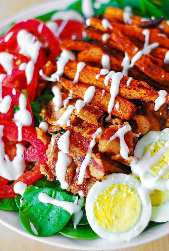 Sweet potato fries, spinach, bacon, eggs, tomato salad with mayo-based dressing