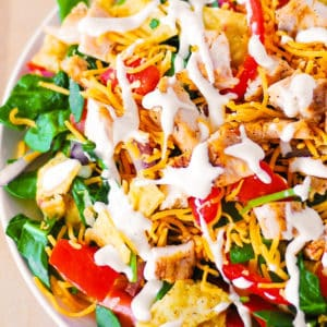 chicken taco salad with spinach, tomatoes and cheddar