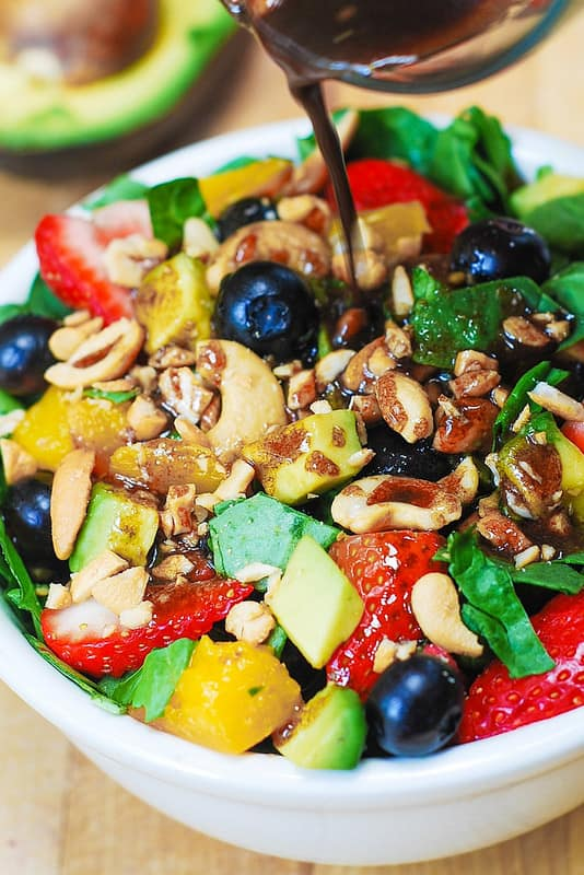 Strawberry Spinach Salad with Mango, Avocado, Blueberries, and Cashew Nuts, tossed with a simple homemade balsamic vinaigrette