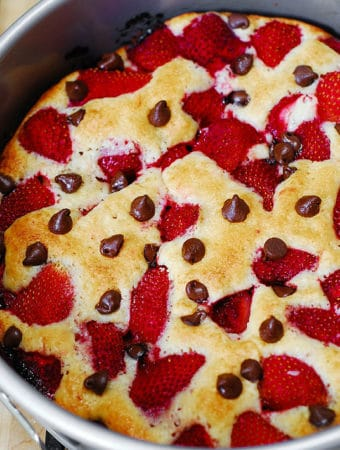 strawberry chocolate chip cake in a springform baking pan