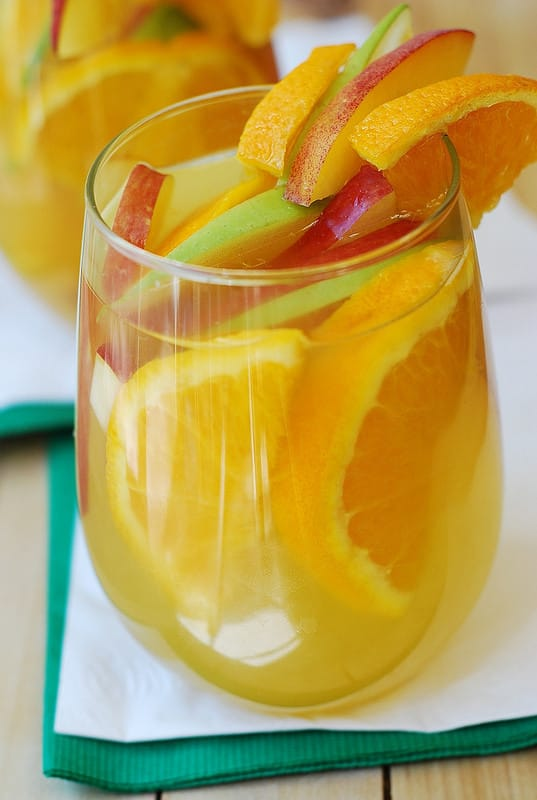White sangria with dry white wine, Peach Schnapps, brandy, orange juice and lots of fruit, such as peaches, apples, oranges