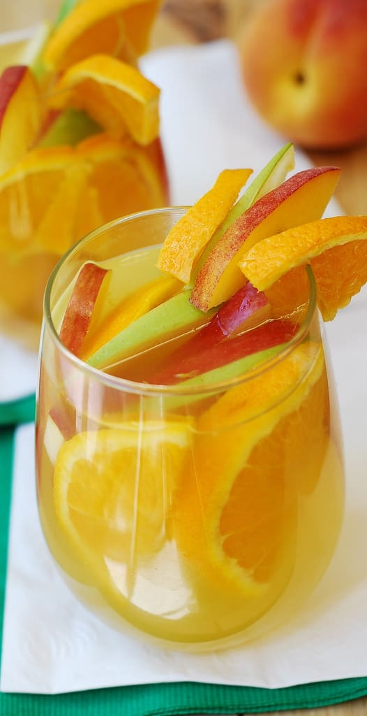 White sangria made with dry white wine, Peach Schnapps, brandy, orange juice and lots of fruit, such as peaches, apples, oranges