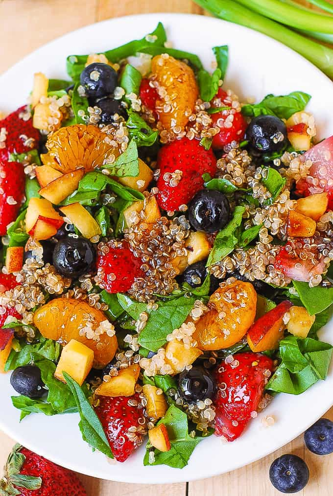 Quinoa salad with spinach, strawberries, blueberries, peaches, mandarin oranges with balsamic vinaigrette
