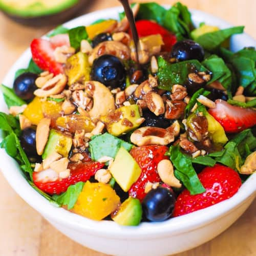 Strawberry Spinach Salad with Mango, Avocado, Blueberries, and Cashew Nuts, with balsamic vinaigrette