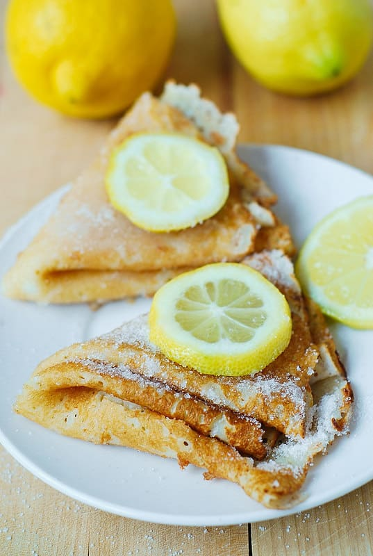 French crepes or blini with lemon slices on top