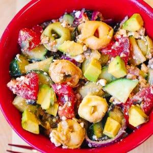 greek tortellini salad with tomatoes, avocado, cucumber