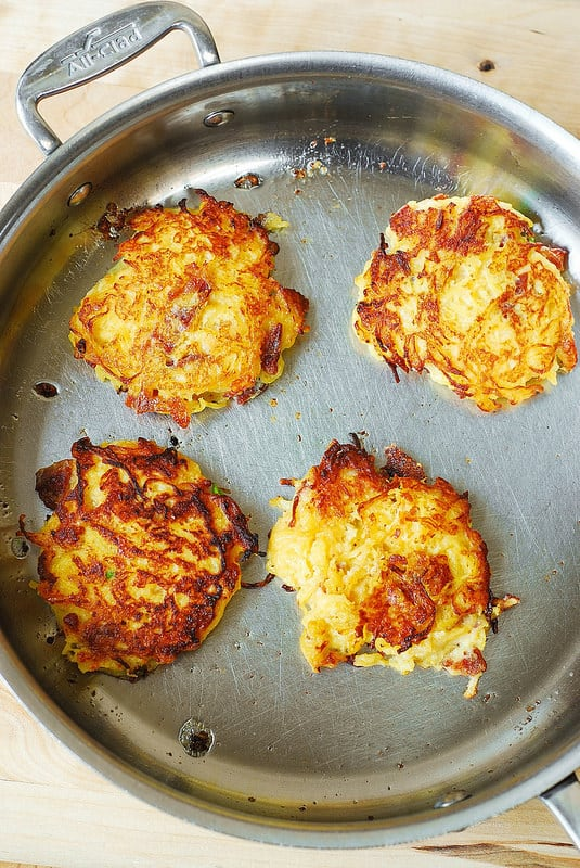 cooking Bacon spaghetti squash fritters on the opposite side