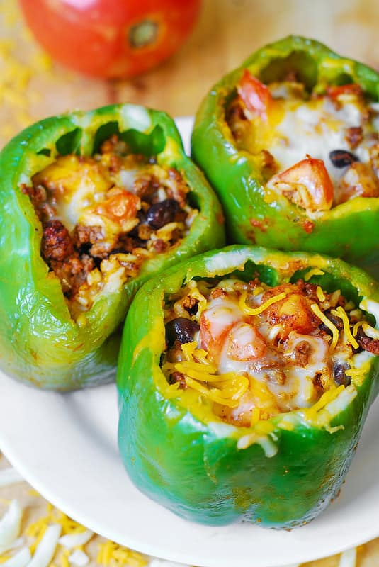 bell peppers stuffed with ground beef, black beans, rice, tomatoes, and cheese