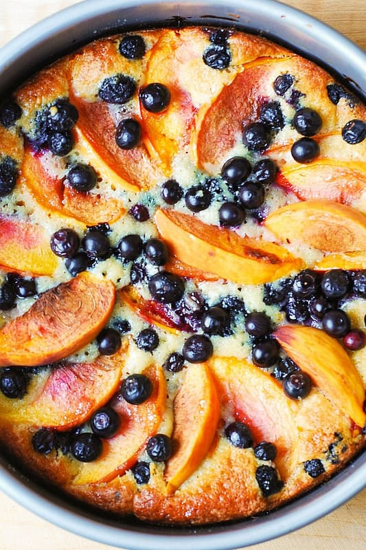 peach cake in springform baking pan, blueberry cake in springform pan, round cake, summer cake