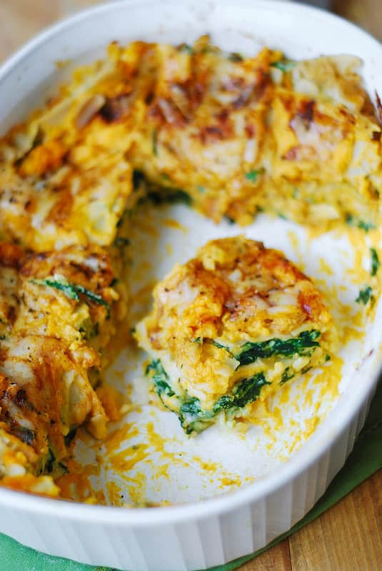 butternut squash and spinach lasagna in a white casserole dish
