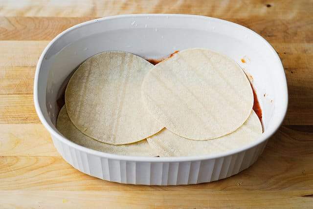 Place 4 corn tortillas over salsa