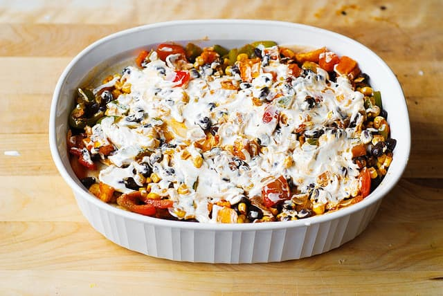 Spread sour cream on top of the veggies