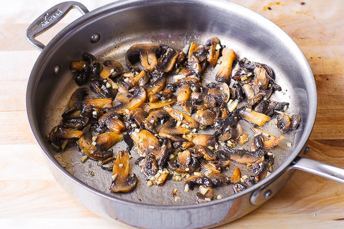 cooking mushrooms and garlic in a large all-clad skillet with butter and olive oil