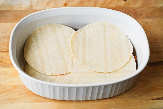 place tortilla at the bottom of the baking dish