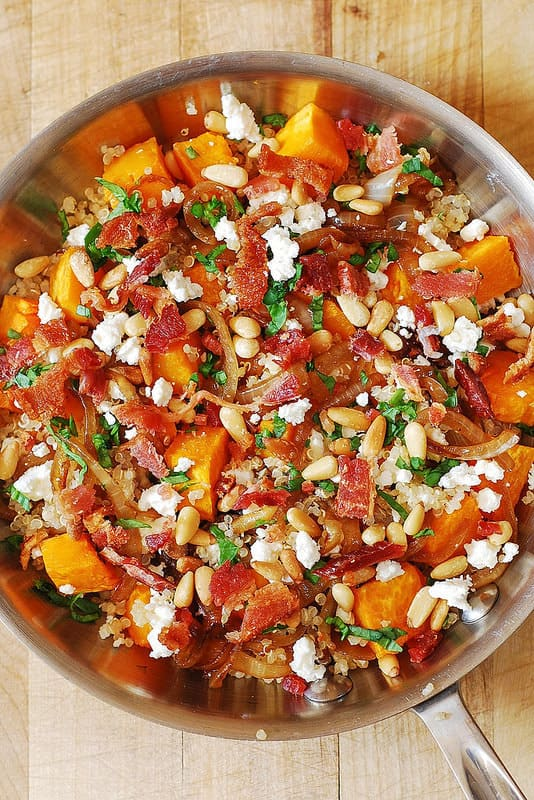 Quinoa and Butternut Squash Salad with Bacon, Caramelized Onions, Feta cheese, and Pine Nuts