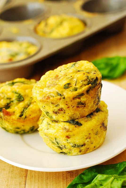 breakfast egg muffins with bacon and spinach and parmesan cheese