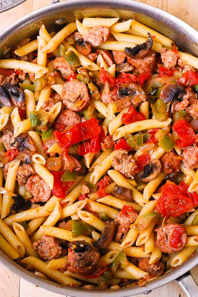 Italian Sausage Pasta with Vegetables, bell peppers, mushrooms, onions, fresh tomatoes in cajun spices, with a splash of red wine!
