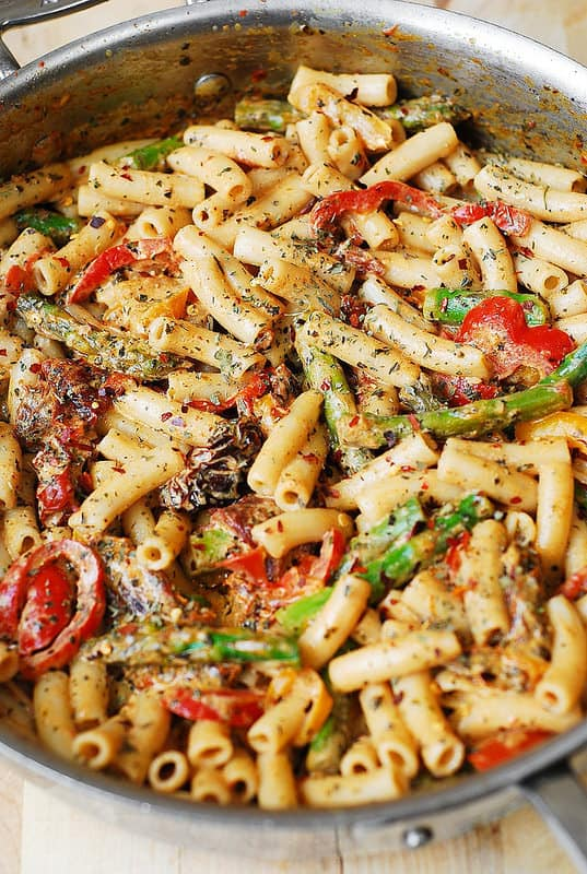 Meatless Vegetable Pasta with Bell Peppers and Asparagus in a Creamy Sun-Dried Tomato Sauce